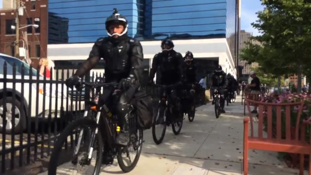 protesters marching through cleveland chanting this is what democracy looks like clip 2 police on bikes are being used to manage protests in... - republikanischer parteitag stock-videos und b-roll-filmmaterial