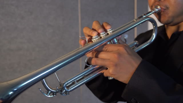 4k clip footage of musician playing button and pushing on trumpet in music room background.planing from right to left, musical concept - brass instrument stock videos & royalty-free footage