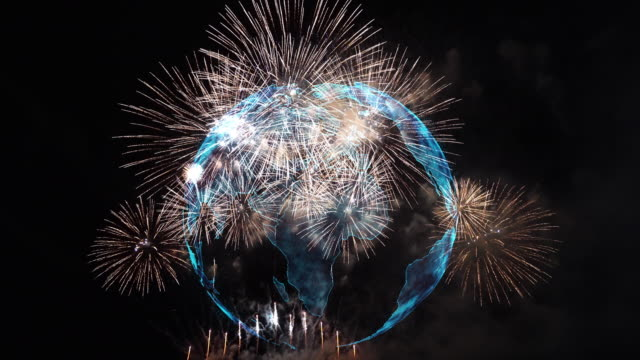 4k clip of multicolor firework celebration over the part of abstract planet earth particle background, independence day concept - july stock videos & royalty-free footage