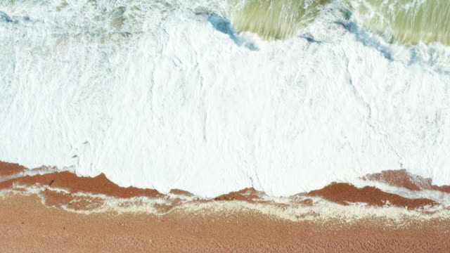 clip of waves rolling onto shingle beach - pebble stock videos & royalty-free footage