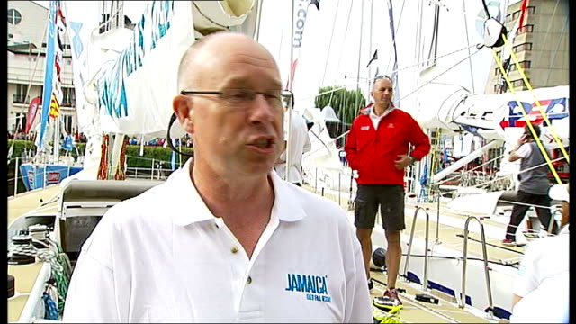 clipper round the world race starts at st katharine docks; england: london: ext nick bush interview sot - changing watch, trying to get boots on and... - all around competition stock videos & royalty-free footage