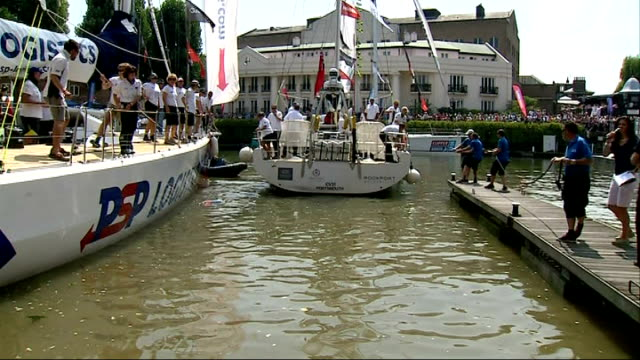 yachts return to london gvs 'jamaica get all right' yacht sails in and docks / crew celebrating / woman in kilt making thumbs up sign / gvs docks... - segelmannschaft stock-videos und b-roll-filmmaterial