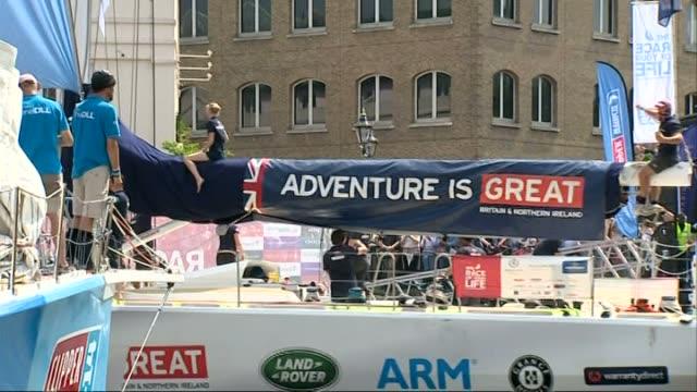 yachts return to london gvs 'derrylondonderrydoire' yacht arrives / 'one dll' yacht moored / crews celebrating on 'great britain' yacht / gvs great... - segelmannschaft stock-videos und b-roll-filmmaterial