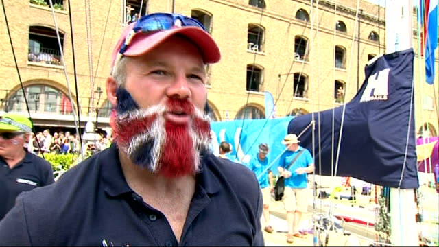 yachts return to london reporter talking to crew member ollie phillips who nhas his beard dyed the colours of the union jack flag ollie phillips... - セーリングチーム点の映像素材/bロール