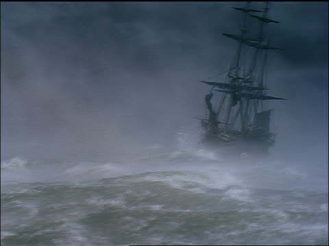 clipper ship being tossed by rough seas during storm / all the brothers were valiant (1953) - sailing ship stock videos & royalty-free footage