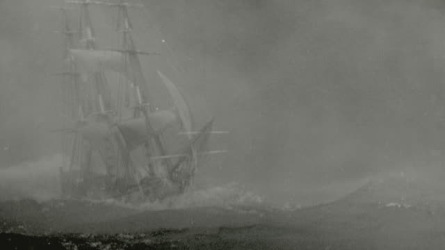 vídeos de stock, filmes e b-roll de b/w clipper ship sailing on rough seas during storm at night / mutiny on the bounty (1935) - rough