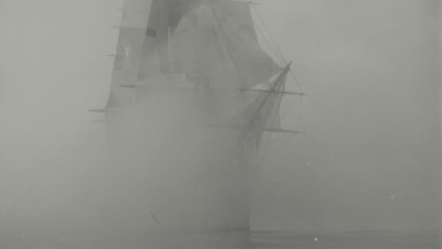 B/W clipper ship sailing through fog towards camera / Mutiny on the Bounty (1935)