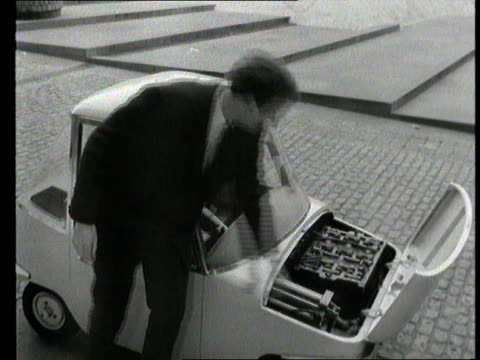 part 1; tx 21.3.1966 electric car 'the scamp' - itn reporter peter snow demonstrates small electric car called 'the scamp' sot - peter snow stock videos & royalty-free footage