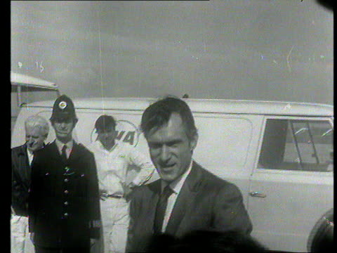 part 1 tx playboy bunnies along at london airport / hugh hefner interviewed by itn reporter michael nicholson on his millions sot - hugh hefner stock videos & royalty-free footage