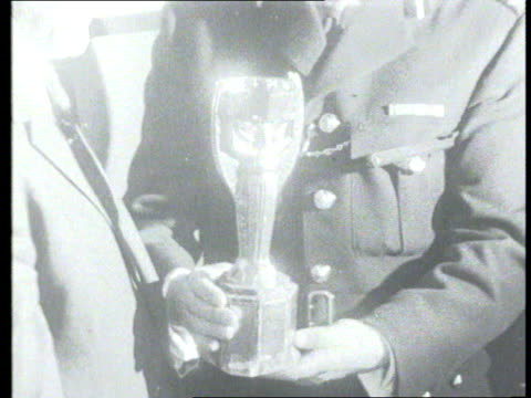 part 1 tx world cup is found shows policemen holding world cup and pickles the dog sniffing at the bush where he found it - 1966 stock-videos und b-roll-filmmaterial