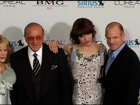clive davis and milla jovovich at the clive davis' 2005 pregrammy awards party arrivals at the beverly hilton in beverly hills california on february... - milla jovovich stock videos and b-roll footage