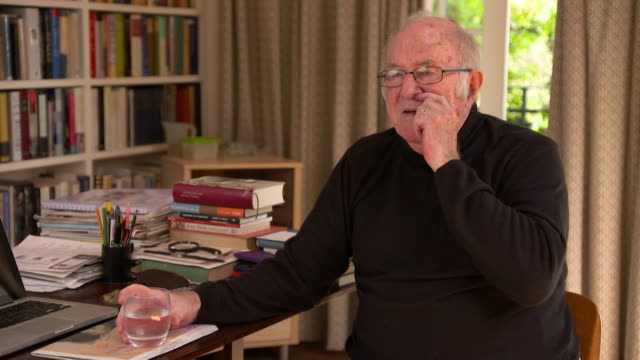clive james on the 'social movement' of consumers staying at home to watch television - social movement stock videos and b-roll footage