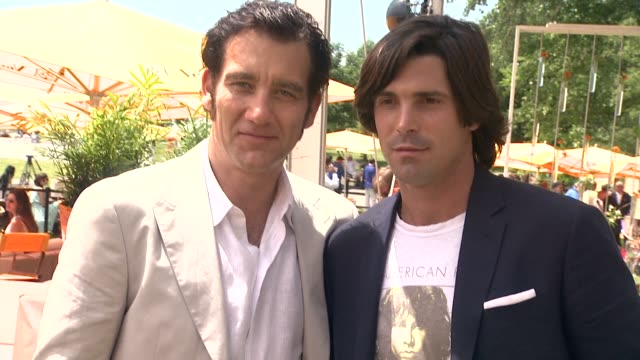 clive owen and nacho figueras at the fifth annual veuve clicquot polo classic on 6/02/2012 in new york ny united states - 動物を使うスポーツ点の映像素材/bロール