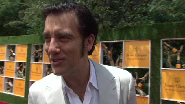 clive owen on being invited to his first polo at the fifth annual veuve clicquot polo classic at liberty state park on june 02 2012 in jersey city... - 動物を使うスポーツ点の映像素材/bロール