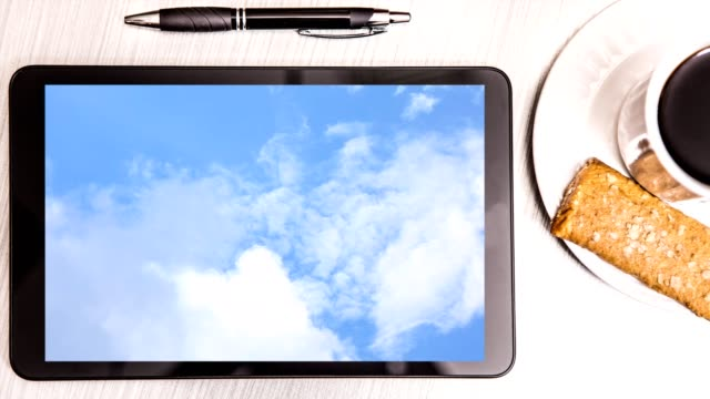 Cllouds on digital tablet screen ready for your own words.