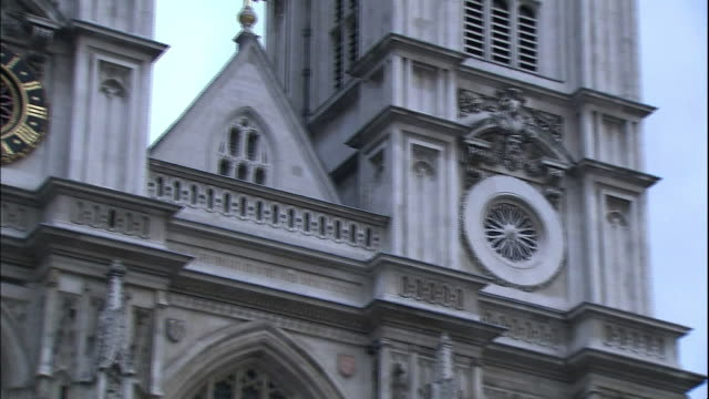 a clock adorns westminster abbey. - instrument of time stock videos & royalty-free footage