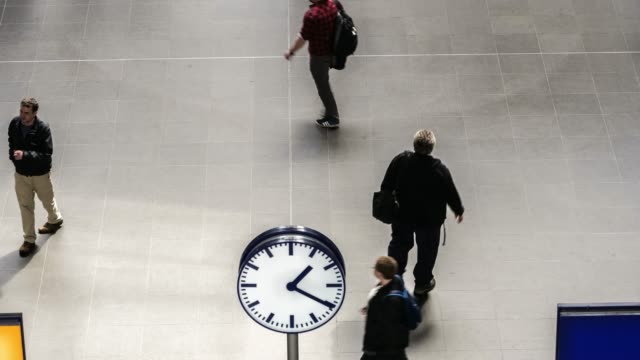 clock and travellers in station - underground station stock videos & royalty-free footage