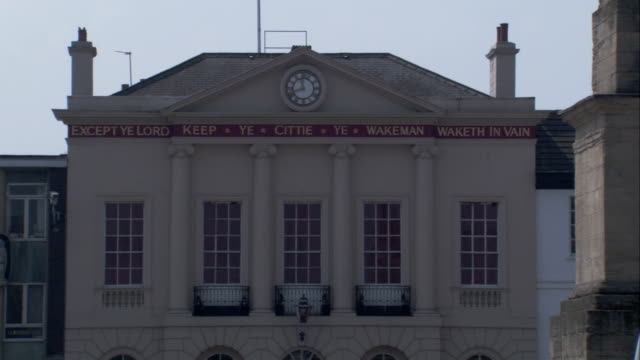 A clock and wording from a psalm decorate the exterior of Ripon town hall. Available in HD.