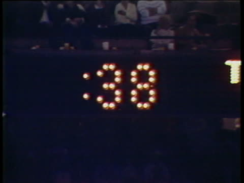 1984 MS DEFOCUS clock counting down from 40 seconds during USFL football game between the Michigan Panthers and the Pittsburgh Maulers/ Pontiac, Michigan