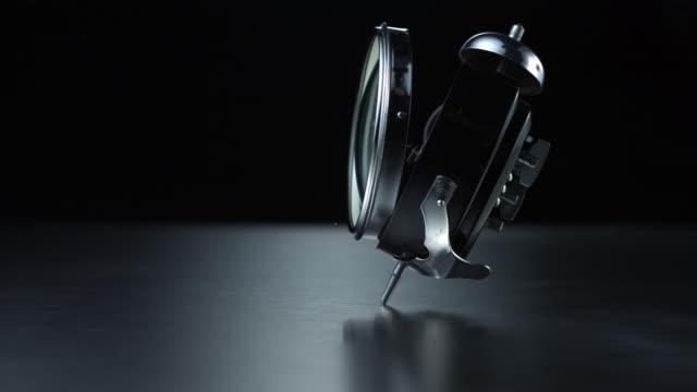vídeos de stock e filmes b-roll de clock crashing on the floor, slow motion-close up - partir