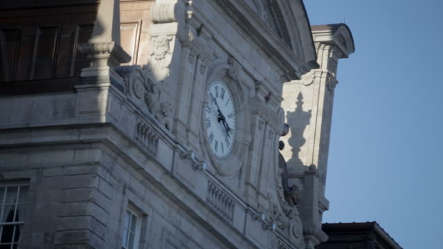 a clock on an old building - international landmark stock videos & royalty-free footage