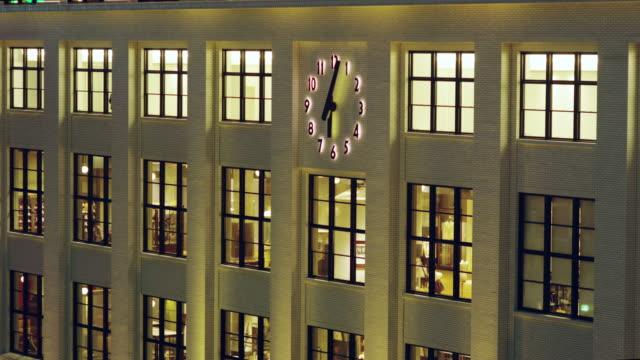 vídeos y material grabado en eventos de stock de clock on the facade of the former central post office building - personas en el fondo