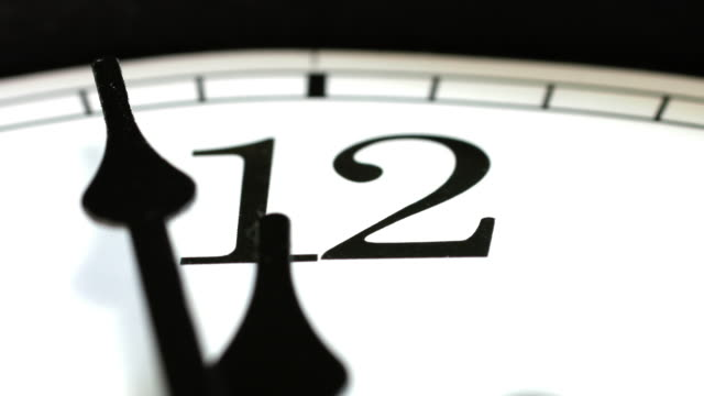 clock passing 12 o'clock midnight. - changing clock stock videos and b-roll footage