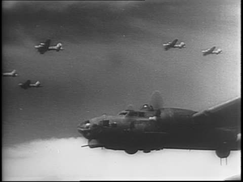 50 pm / bombers including Boeing B17 Flying Fortresses and B26 Marauders fill skies / aerial island of Guernsey / aerial shoreline of France with and...