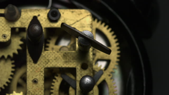 clock ticking, back side of clock, slow motion-close up - uhr stock-videos und b-roll-filmmaterial