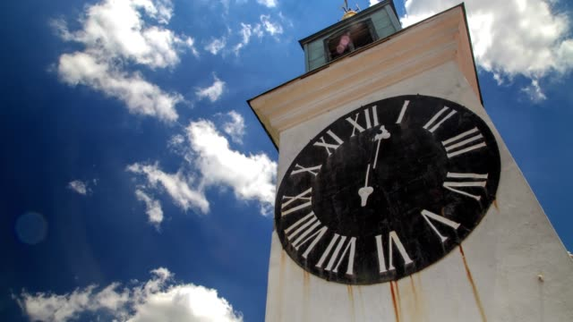 clock tower and cloudy weather (low angle wiew) - hyper lapse stock videos & royalty-free footage