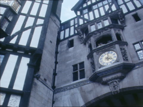 a clock tower and english tudor architectural style characterize the liberty department store in london. - department store stock videos and b-roll footage