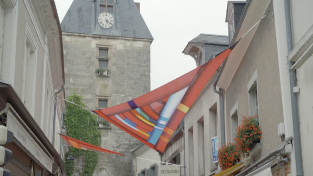 clock tower and town street / loire france - bell tower tower stock videos and b-roll footage