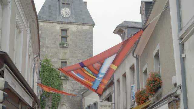 clock tower and town street / loire france - klocktorn bildbanksvideor och videomaterial från bakom kulisserna
