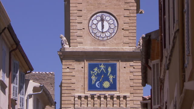 A clock tower features two different clock faces.