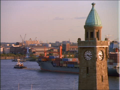 clock tower foreground / tugboat + freighter in river in background / hamburg - 1992 stock-videos und b-roll-filmmaterial