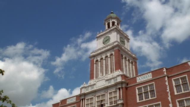 la  time laps clock tower of east high scool  denver  colorado  usa - facade stock videos & royalty-free footage