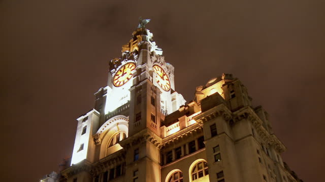 MS, LA, Clock tower of Royal Liver Building illuminated at night, Liverpool, England