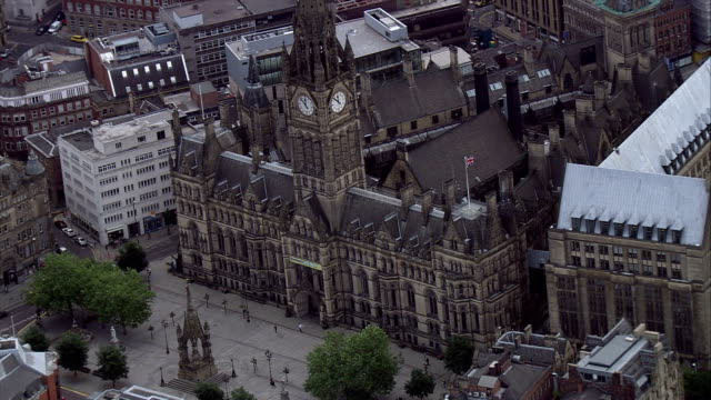 a clock tower rises from the centre of manchester town hall. available in hd. - manchester england stock videos & royalty-free footage