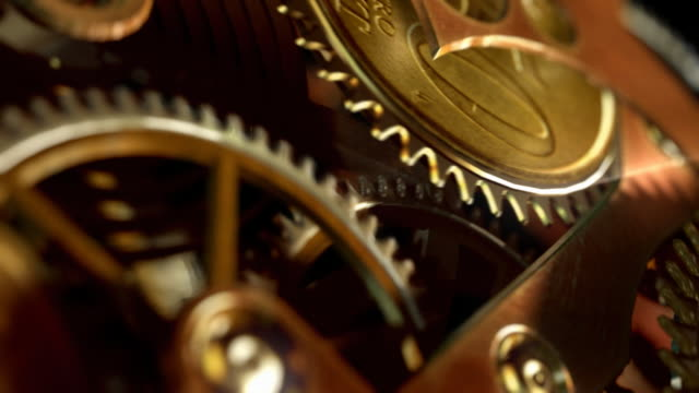 clock with coins in place of gears. time is money. - machine part stock videos and b-roll footage