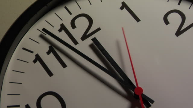 t/l, ecu, clock with hands approaching and passing 12 - midnight stock videos & royalty-free footage