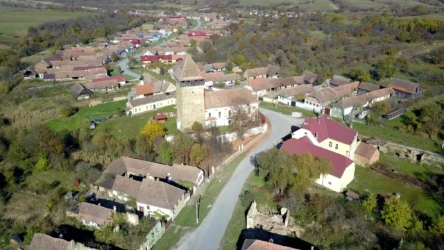 vídeos y material grabado en eventos de stock de clockwise flight around the fortified church in barcut - transilvania