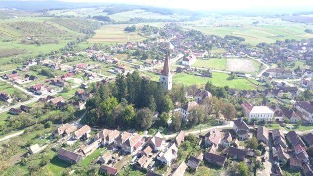 clockwise flight around the fortified church in cincu - siebenbürgen stock-videos und b-roll-filmmaterial