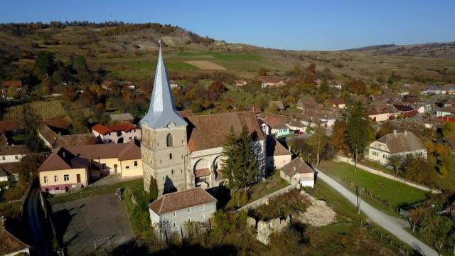 clockwise flight around the fortified church in soars - siebenbürgen stock-videos und b-roll-filmmaterial