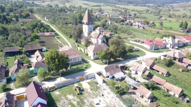 clockwise flight around the fortified church in toarcla - transilvania video stock e b–roll