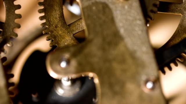 clockwork gears working - clockworks stock videos & royalty-free footage