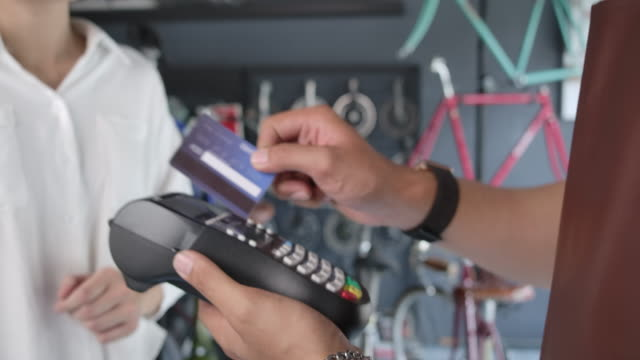 cloes up credit cards machine, bicycle shop owner this shop is a small business. that accept payment by credit card - credit card purchase stock videos & royalty-free footage