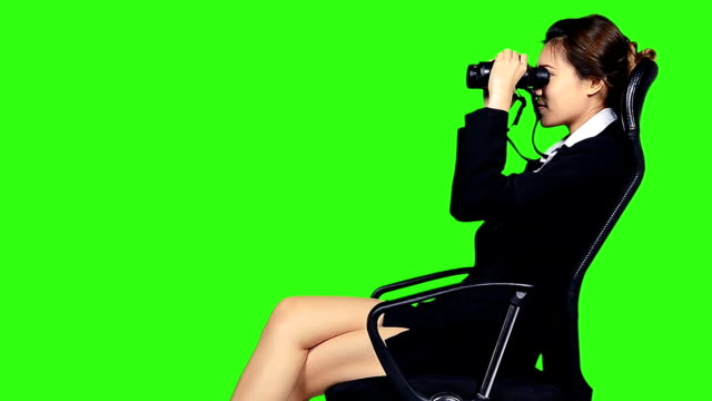 cloese up business woman sitting on a chair with binocular - keyable stock videos & royalty-free footage