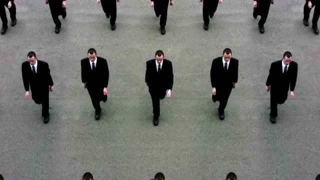 cloned businessmen, ready for world domination - marciare video stock e b–roll