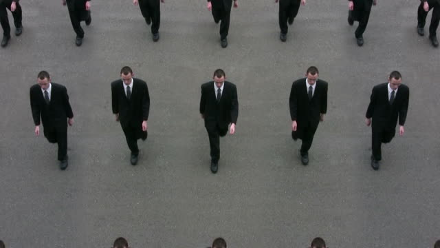 cloned businessmen - marching stock videos & royalty-free footage