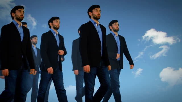 cloned businessmen walking - repetition stock videos & royalty-free footage